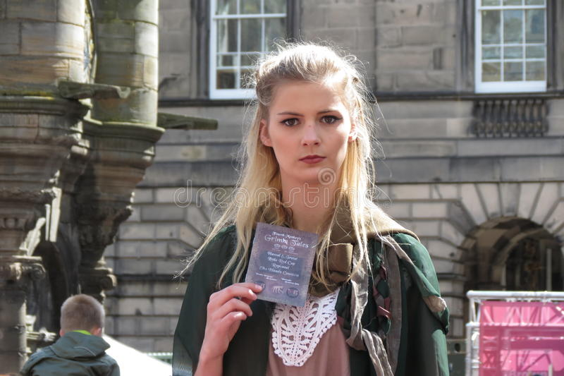 Girl advertising theatre play at the Fringe Festival stock photography