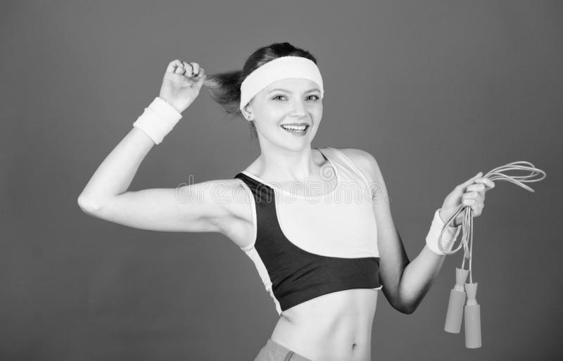 Girl in aerobics class. Woman exercising with jump rope. Fitness exercises with jump rope. Workout with jump rope. Girl. Like jumping exercises. Prepare summer stock photography