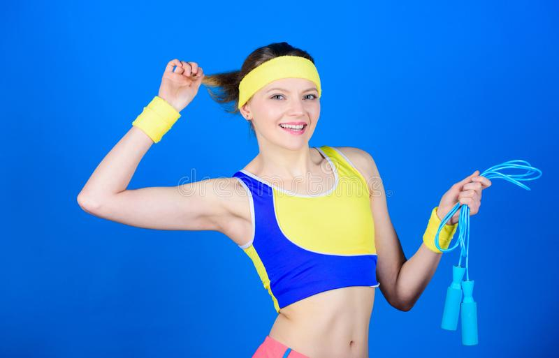 Girl in aerobics class. Woman exercising with jump rope. Fitness exercises with jump rope. Workout with jump rope. Girl. Like jumping exercises. Prepare summer royalty free stock photos