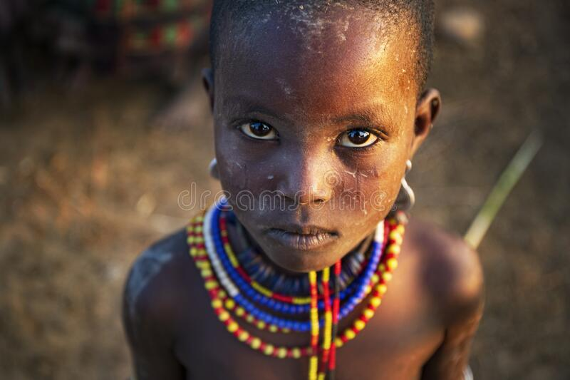 Girl from the african tribe Dassanech poses for a portrait, Mago National Park stock photography