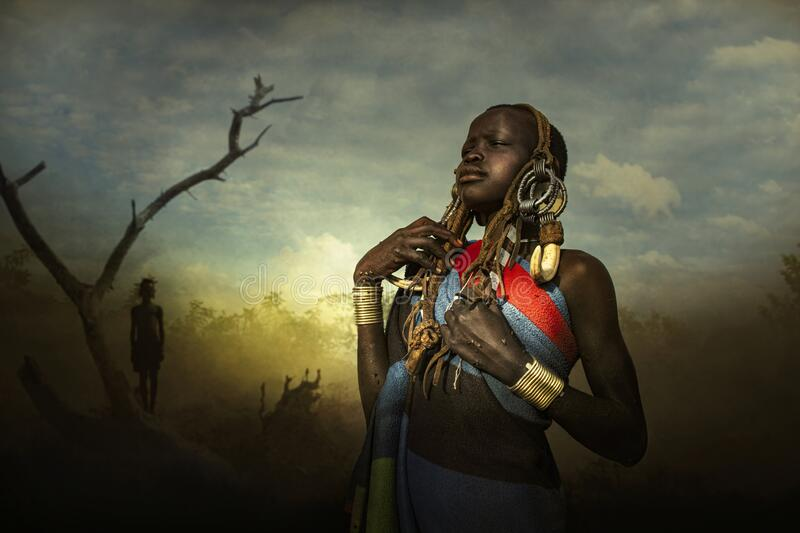 Girl from the African tribe Mursi, Ethiopia royalty free stock image