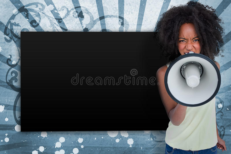 Girl With Afro Shouting Through Megaphone With Copy Space Royalty Free Stock Image