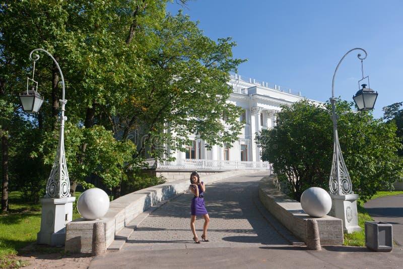 Girl Against Yelagin Palace Stock Images