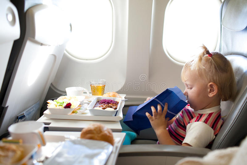 Girl in the airplane royalty free stock photos