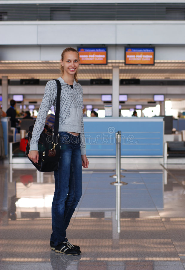 Girl in airport royalty free stock photo