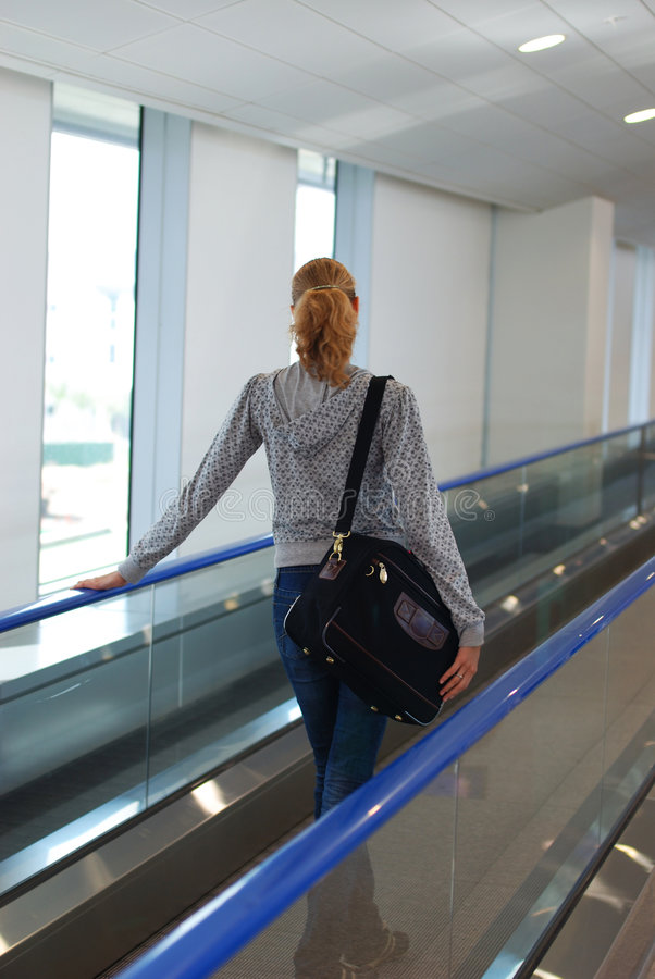 Girl in airport. Woman at the airport, shallow DOF royalty free stock photos
