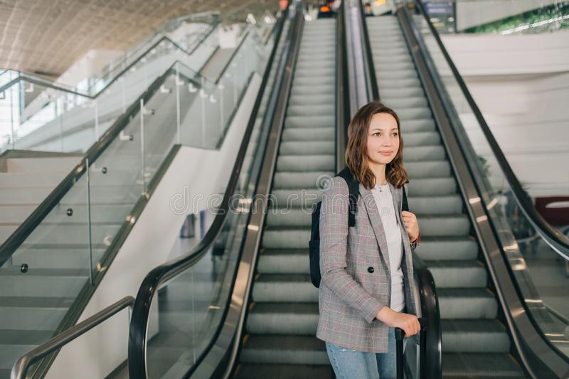 Girl at the airport with suitcase and backpack. royalty free stock images