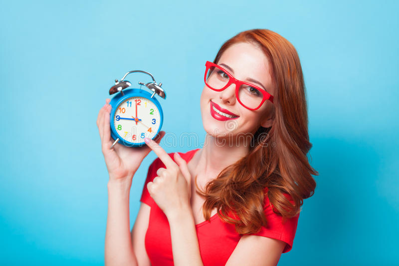 Girl with alarm clock royalty free stock photo