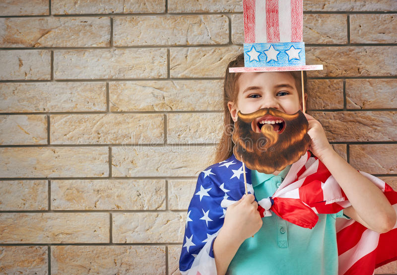 Girl with American flag stock photography