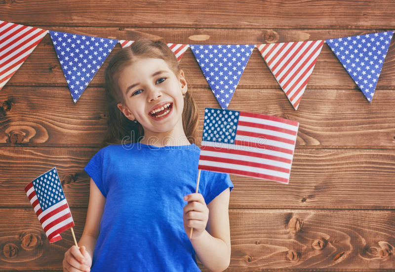Girl with American flag stock photos