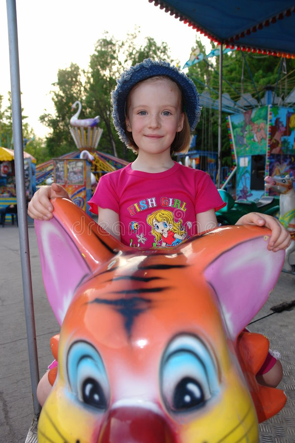 Download The Girl In An Amusement Park Stock Images - Image: 4388564