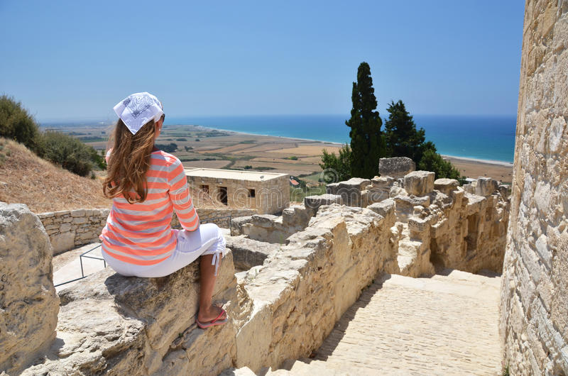 Girl among ancient ruines stock photo
