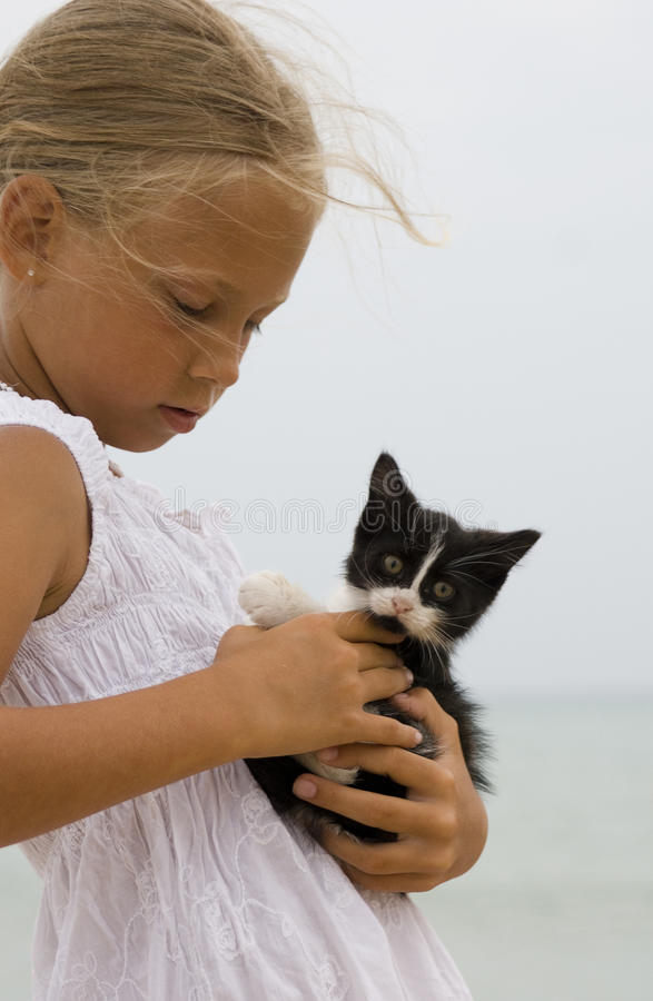 Free Girl And A Kitten Stock Image - 13901721