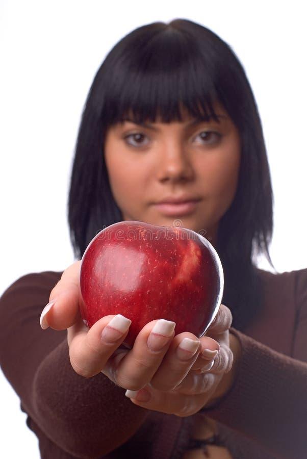 The girl with an apple stock photos
