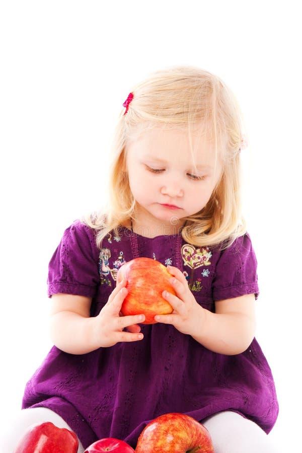 Download Girl and apple stock photo. Image of floor, girl, beautiful - 26015274