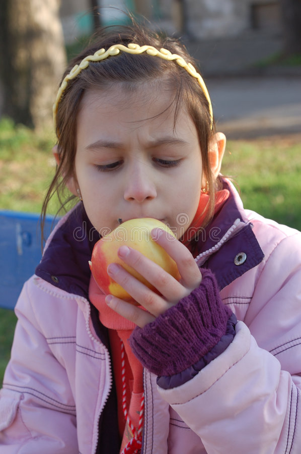 Download Girl with apple stock image. Image of girl, hand, eating - 4597183