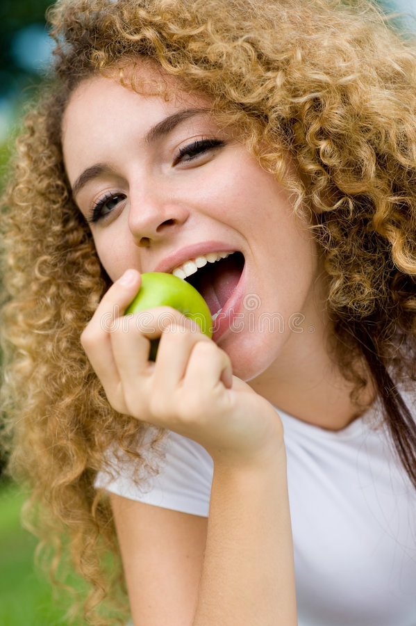Download Girl And Apple Royalty Free Stock Photography - Image: 4957707