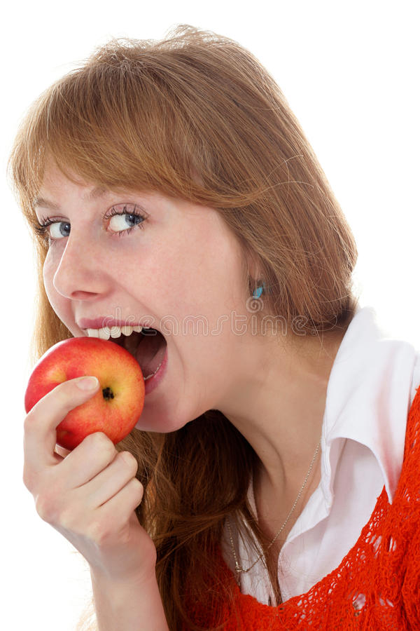 Girl and apple at isolated white stock images