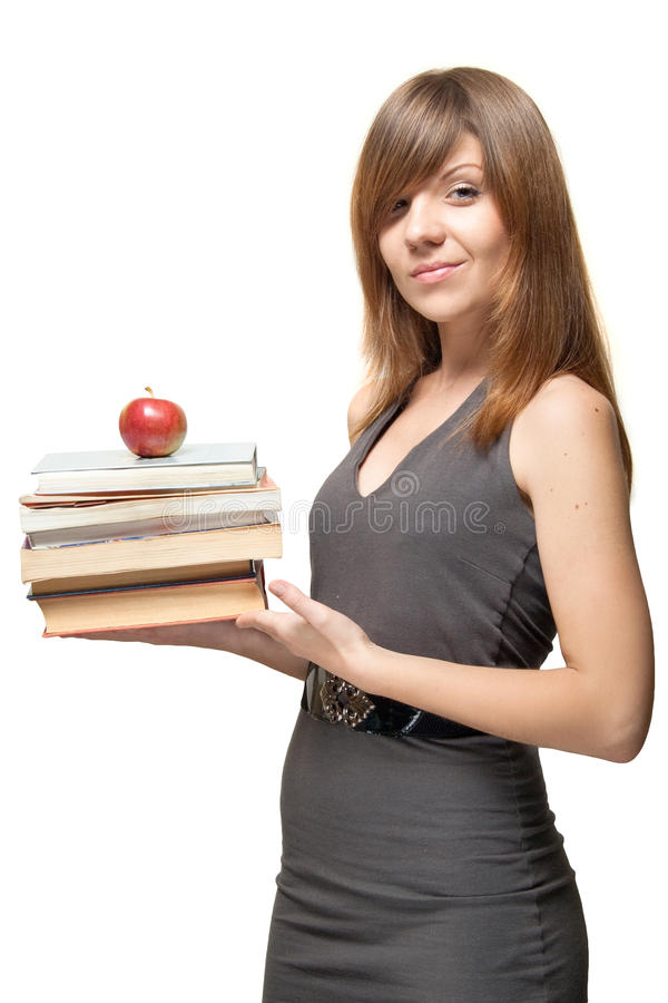 Download Girl With The Apple And A Stack Of Books Royalty Free Stock Photos - Image: 26994878