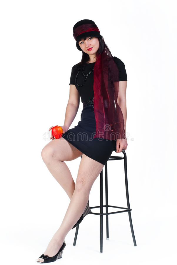 Girl With Apple On Stool Royalty Free Stock Photos