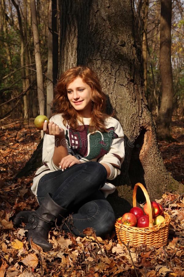 Download Girl with apples stock photo. Image of confident, forest - 27767308