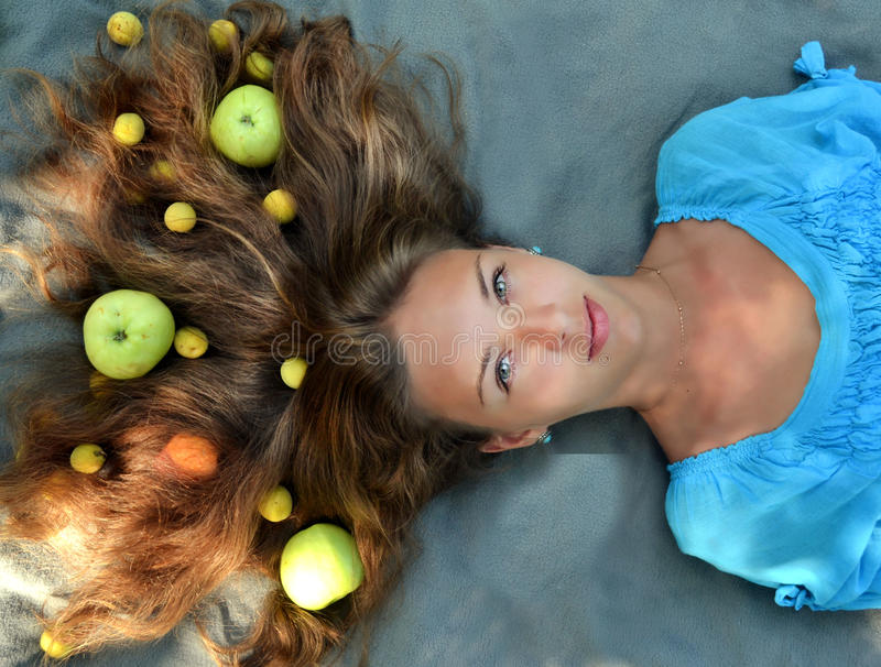 Girl with apples in her hair.Healthy shiny,glossy,perfect hair.Healthy lifestyle.Amazing,beautiful girl with healthy skin and hair stock photography