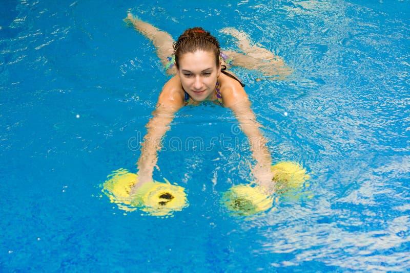 Girl in aqua fitness aerobic stock photography