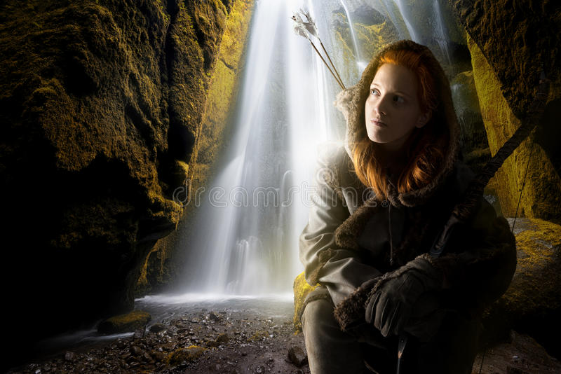Girl archer. Fantasy girl archer in a waterfall with bow stock photography