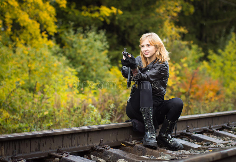 Girl with arms on the rails. In autumn day royalty free stock image