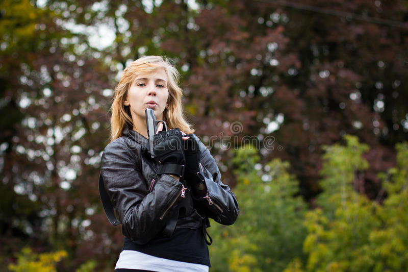 Girl with arms on the rails. In autumn day royalty free stock images