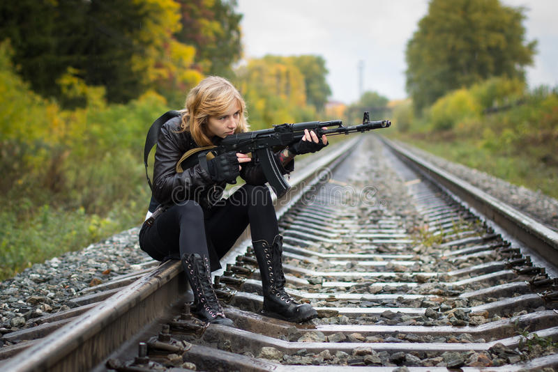 Girl with arms on the rails. In autumn day stock photography