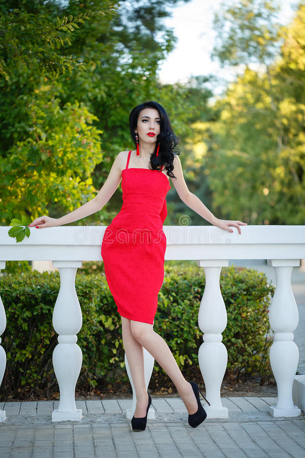 Girl in art deco style. Retro portrait. Attractive brunette girl in the red dress. Portrait in full growth. Art Deco and Art Nouveau. The concept of retro royalty free stock photos