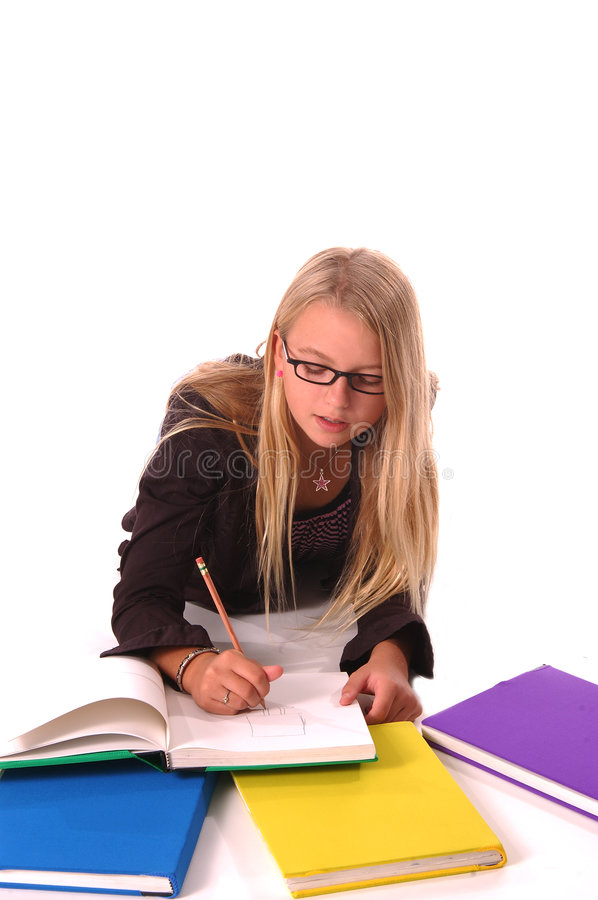 Girl Art Student. Beautiful young female art student sitting on floor sketching in book stock images