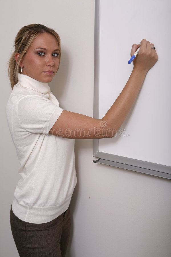 Girl associate at whiteboard close stock photography