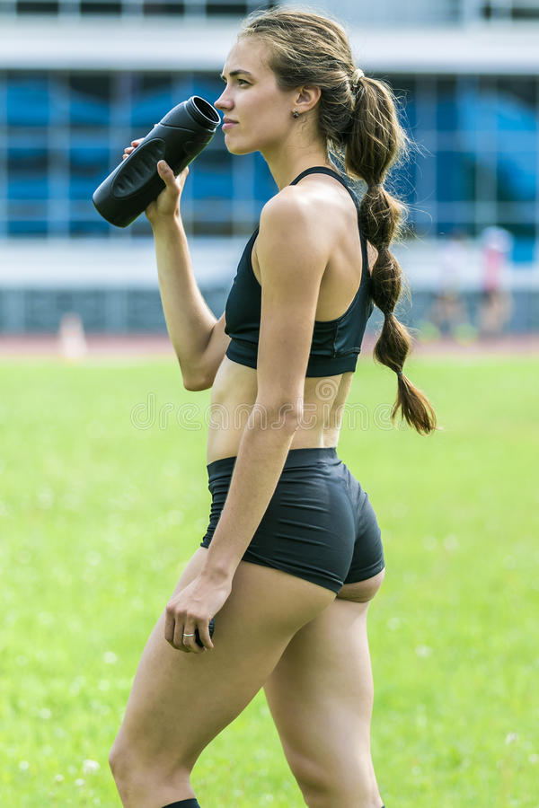 Girl athlete drinking water royalty free stock photo