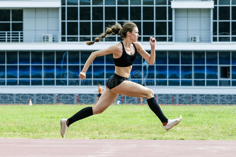 Girl athlete execution of triple jump royalty free stock image