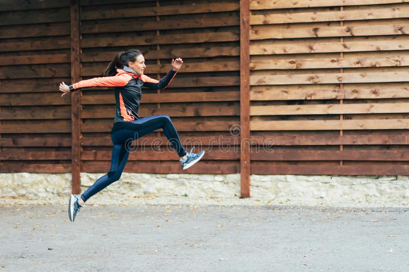 Girl athlete in a high jump. stock images