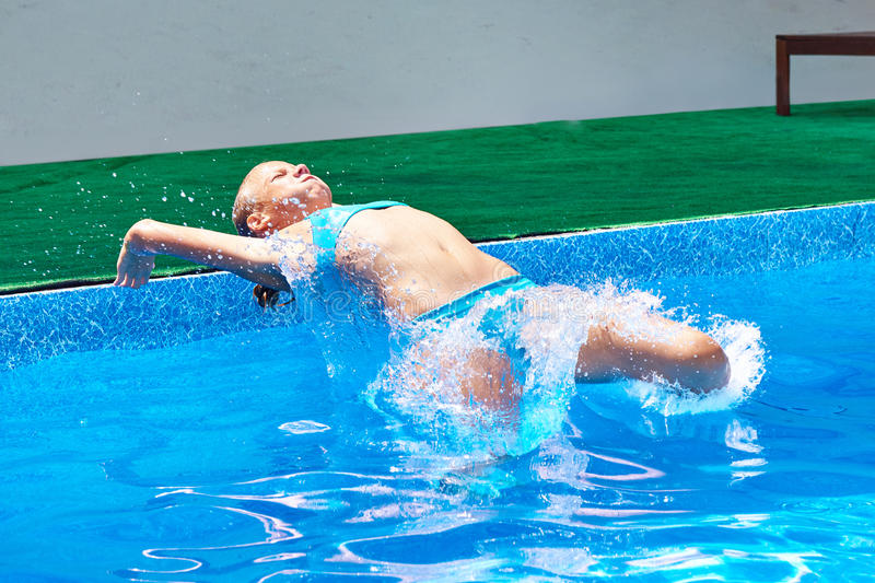 Girl athlete jumping into water royalty free stock image