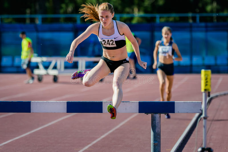 Girl athlete overcomes obstacles royalty free stock photo