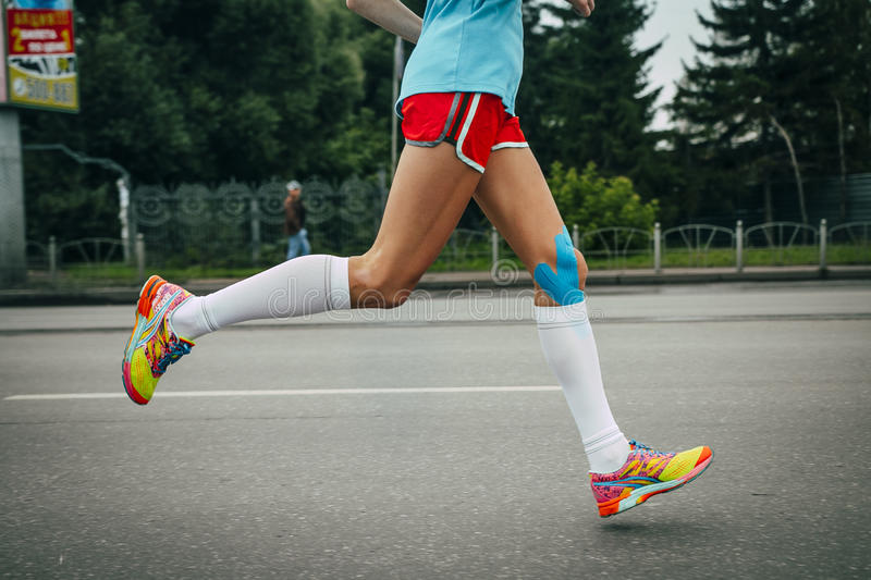 Girl athlete running a marathon royalty free stock photo