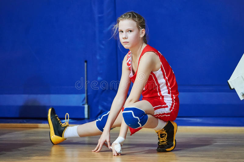 Girl athlete warming up before game. Injuries in Sports royalty free stock photo