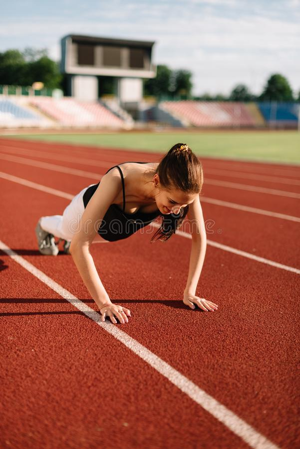 Girl athlete wrung out on the field on a sunny day.  stock photography