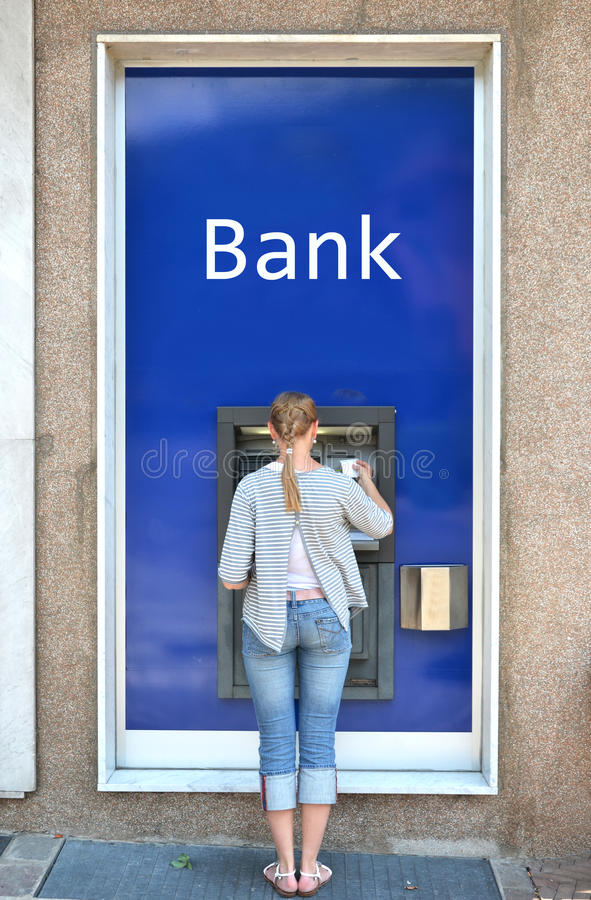 Girl at ATM stock images