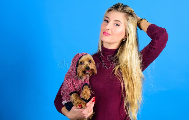 Girl attractive blonde hug cute dog. Apparel and accessories. Pet supplies. Dressing your dog for cold weather. Dogs. Need clothes. Which dog breeds should wear stock photo