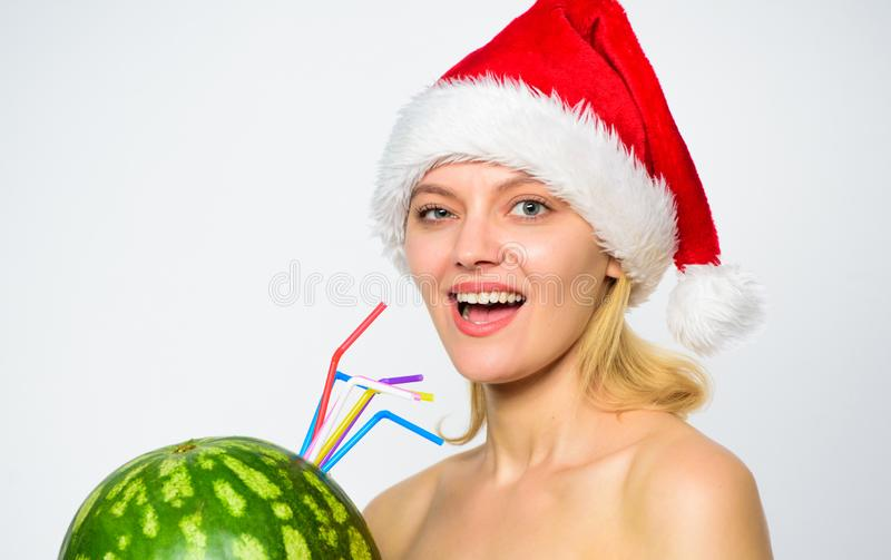 Girl attractive nude wear santa hat drink juice watermelon cocktail straw white background. Winter detox concept royalty free stock photography