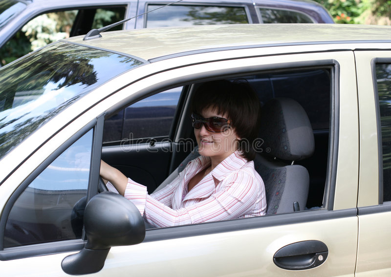 The girl in the automobile royalty free stock photos