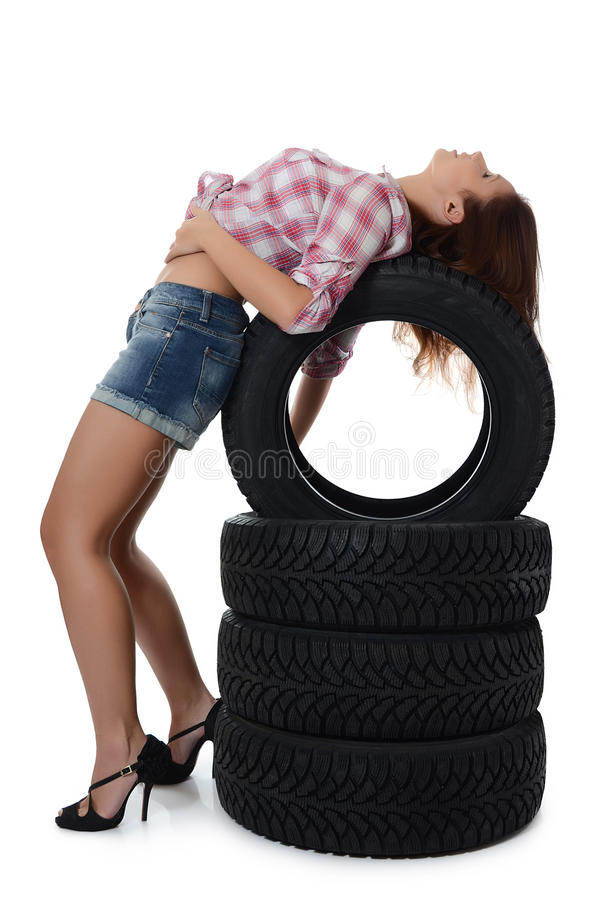 Download The Girl With Automobile Tyres Stock Photo - Image: 27439470