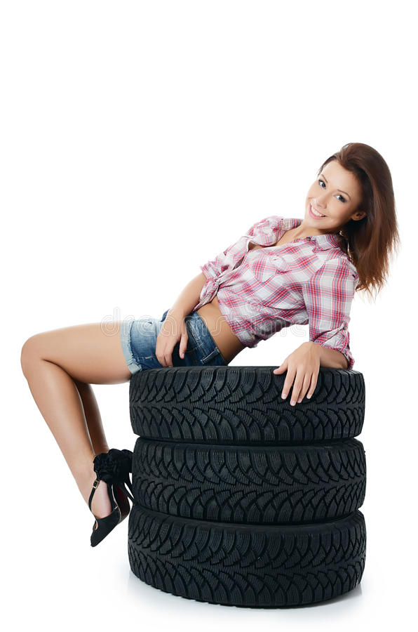 Girl with automobile tyres royalty free stock image