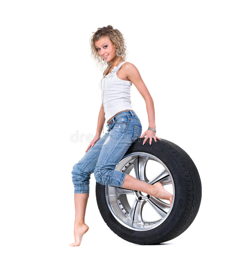 Girl With Automobile Tyres Stock Photo