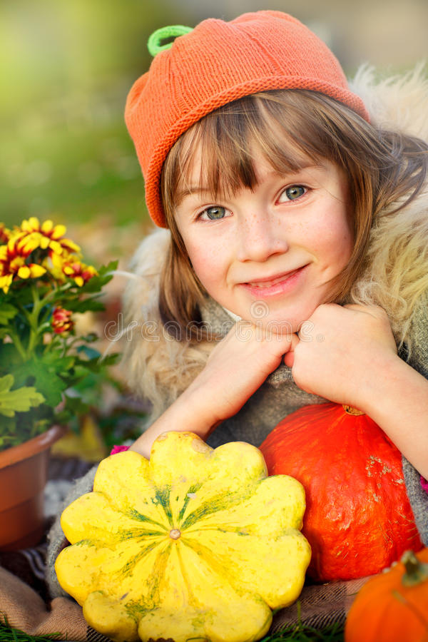 Download Girl In Autumn Clothes With Pumpkins Stock Image - Image: 35279595
